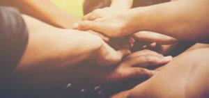 All hands in center showing teamwork